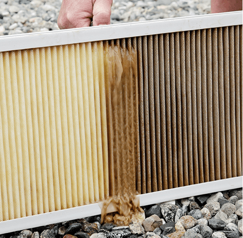 washing dirty home air filter